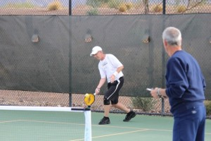 Pickleball Paddles flying everywhere.